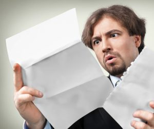 surprised person receiving a FATCA letter
