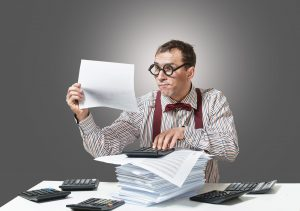 IRS auditor closely examines records while doing attorney audit