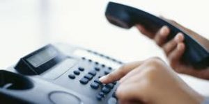 Photo of scammers dialing taxpayers for IRS tax scams