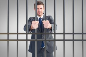 man in suit in jail