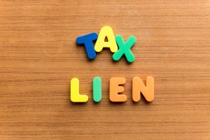 Avoiding an IRS tax lien without paying your full tax balance