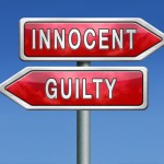 sign showing innocent one way and guilty another