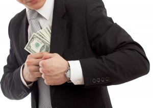 Structuring to evade reporting requirements: photo of man hiding money in his jacket